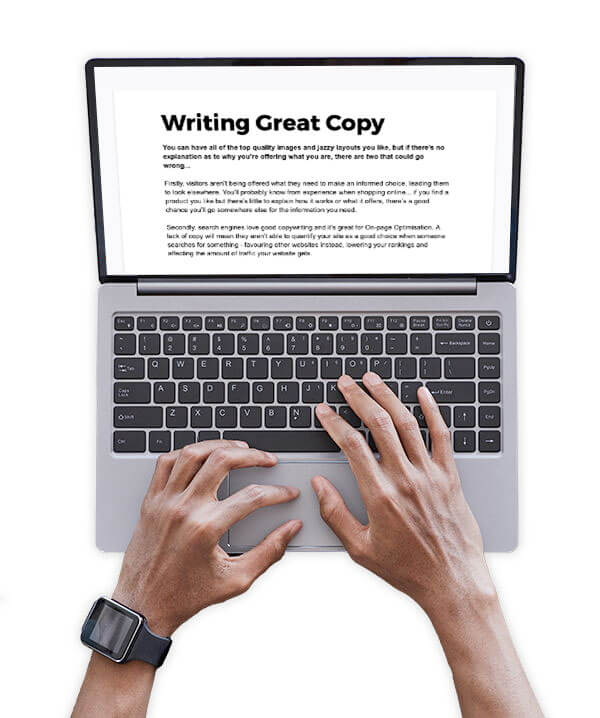 A man copywriting on a laptop